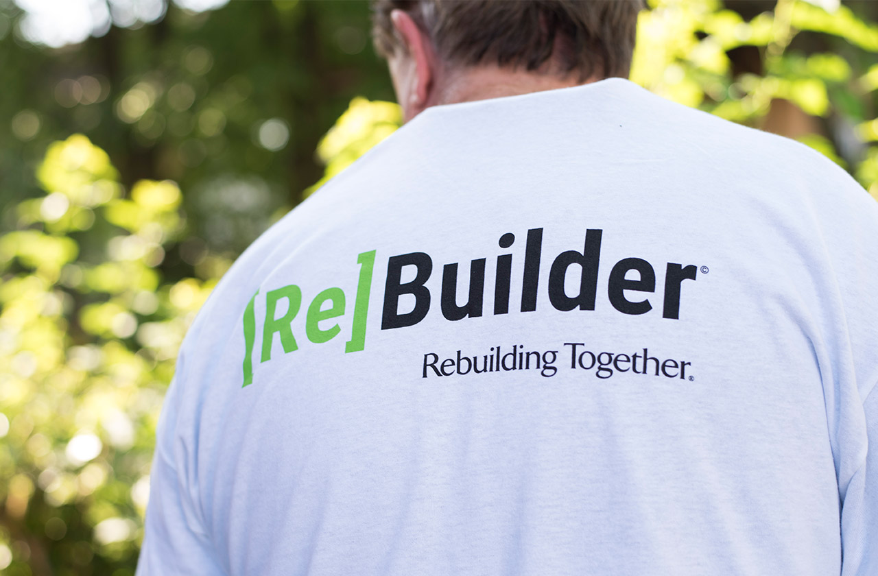 The back of a volunteer's [Re]Builder t-shirt.