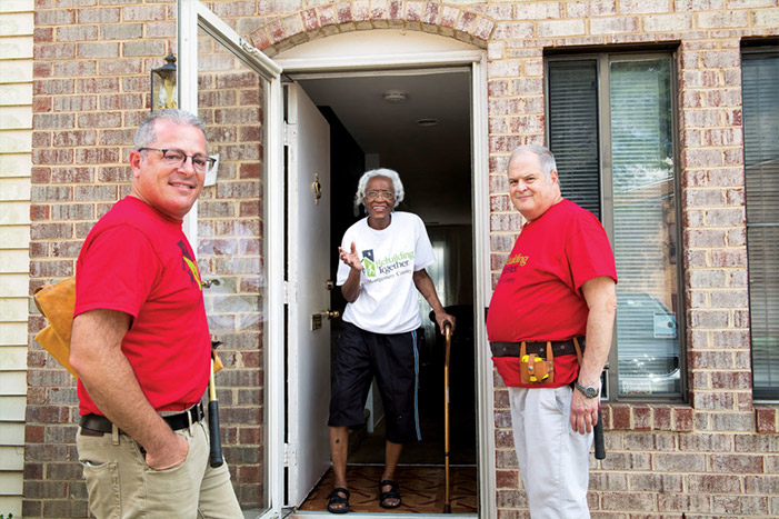Jason Sheer (left) and David Baum helped make improvements on Eula Knight's home as volunteers with Rebuilding Together Montgomery County.