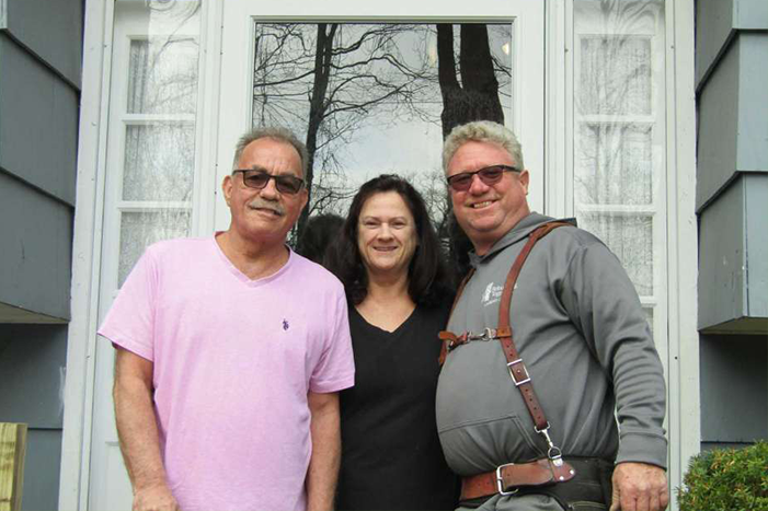 George and Karen Zigmantanis, center and left, are joined by Michael Boges, chairman of Rebuilding Together of Litchfield County.