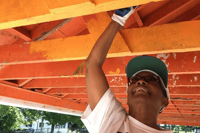 Donna Blackwell, president of the York Road Partnership, volunteers to help paint the pavilion at Willow Avenue Park during a two-day community improvement event in the Wilson Park neighborhood organized by Rebuilding Together Baltimore. (Sarah Gantz / The Baltimore Sun)
